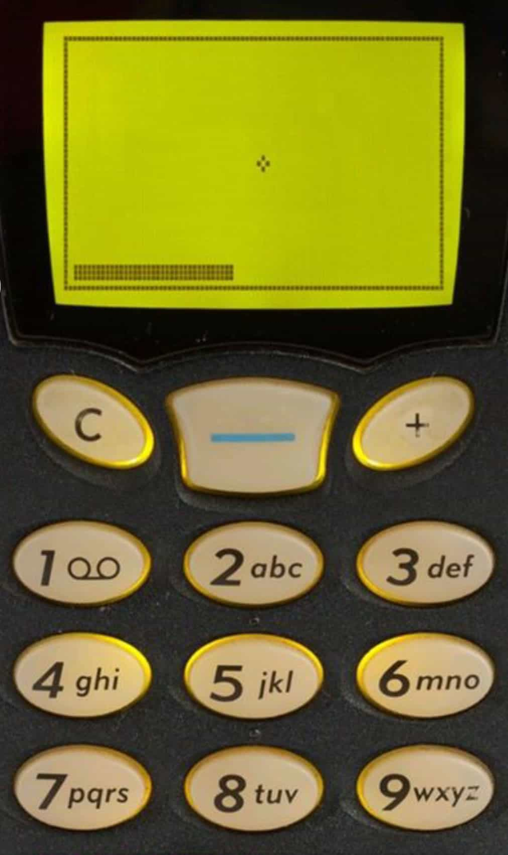 "A photo of the game ""Snake"" on a monochromatic cell phone screen."