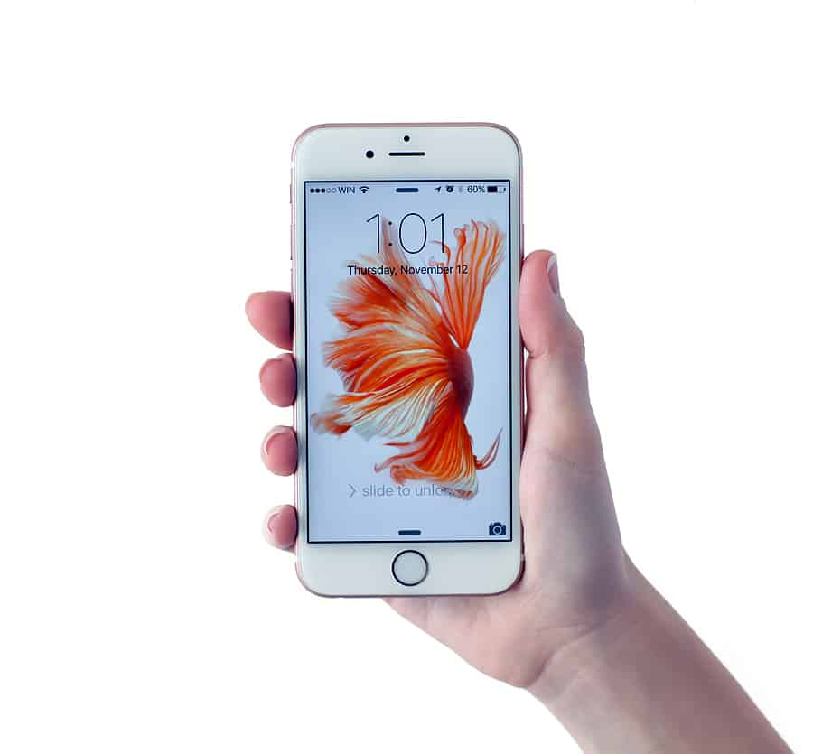 A photo of a rose gold iPhone 6S in someone's hand.