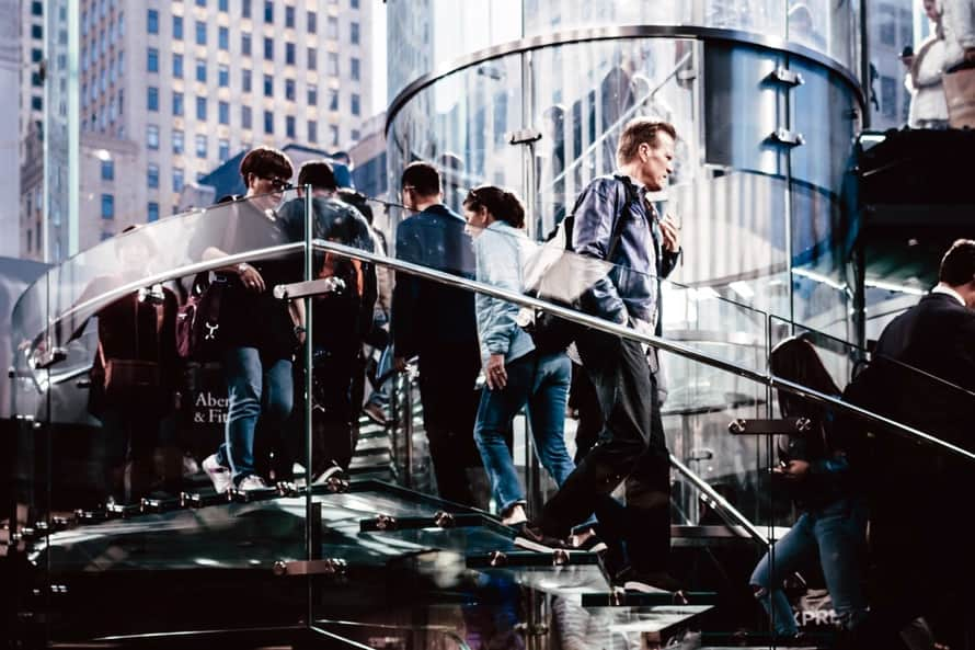 Image of people walking up and down a modern set of stairs.