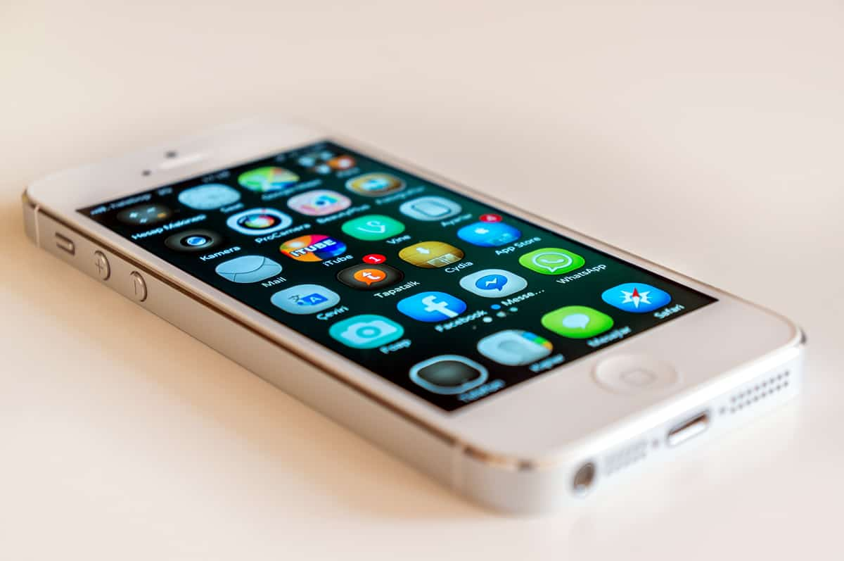 A photo of a white iPhone full of apps.