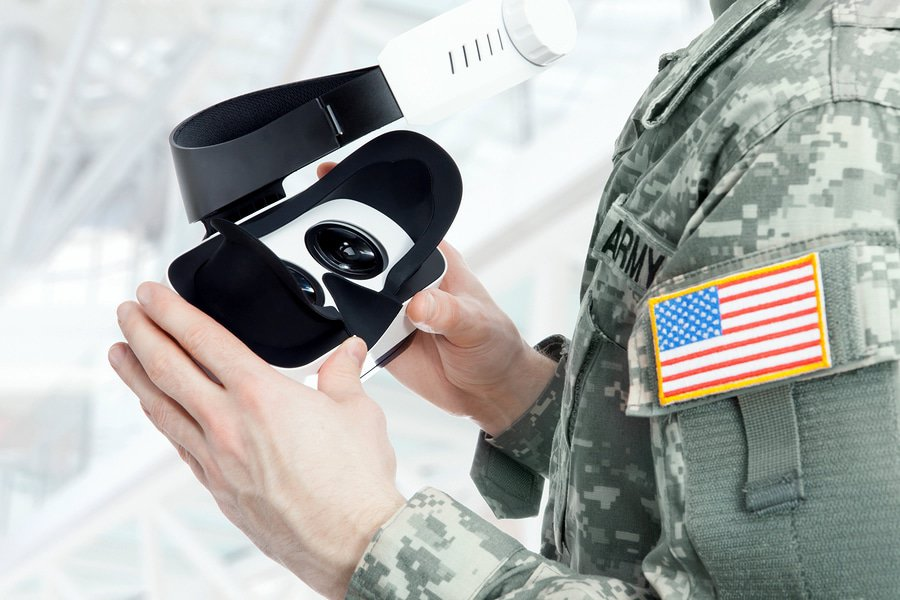 A photo of an American soldier holding a virtual reality headset.