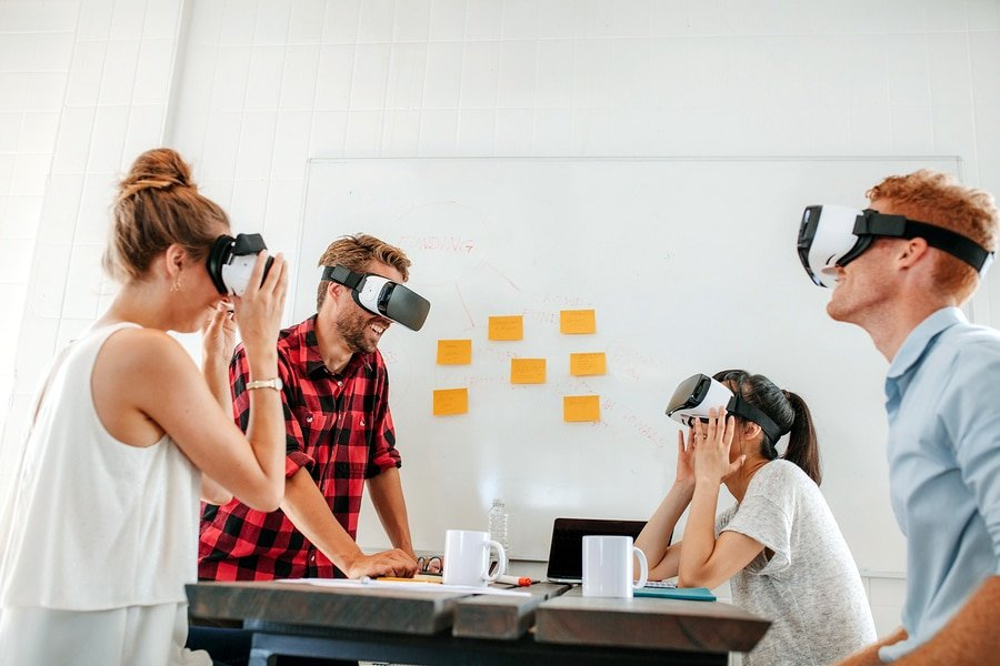 A photo of a work group finding new uses for virtual reality in their office.
