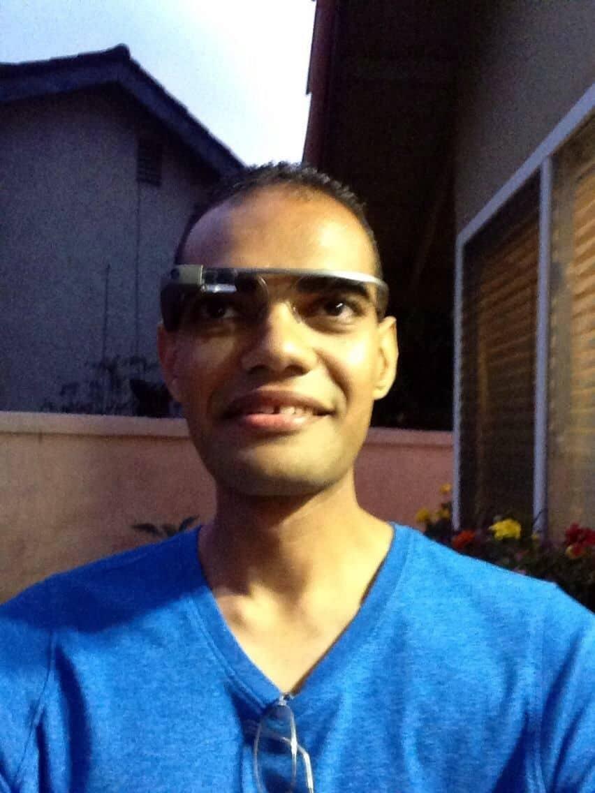A man wearing Google Glass.