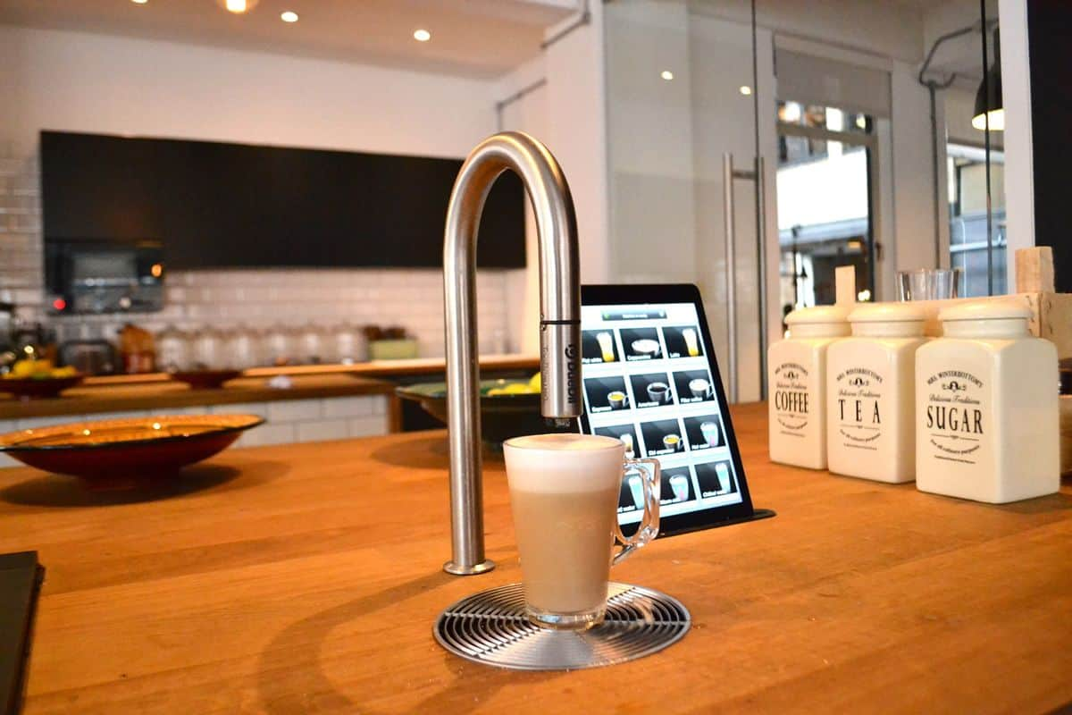 TopBrewer coffee makers integrated into your kitchen, shown here as a tap next to an ipad.