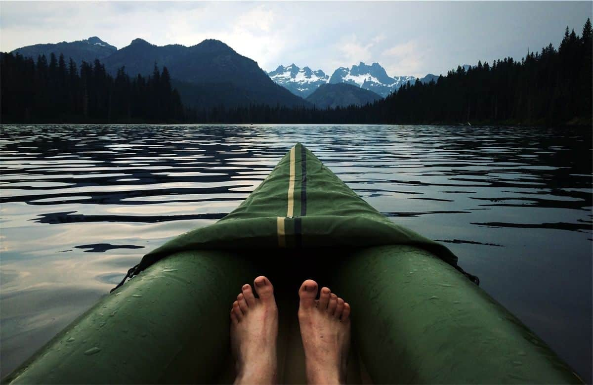 Feet in a floating boat on a lake. Find out what floats your mobile app development team's boat to better support them.