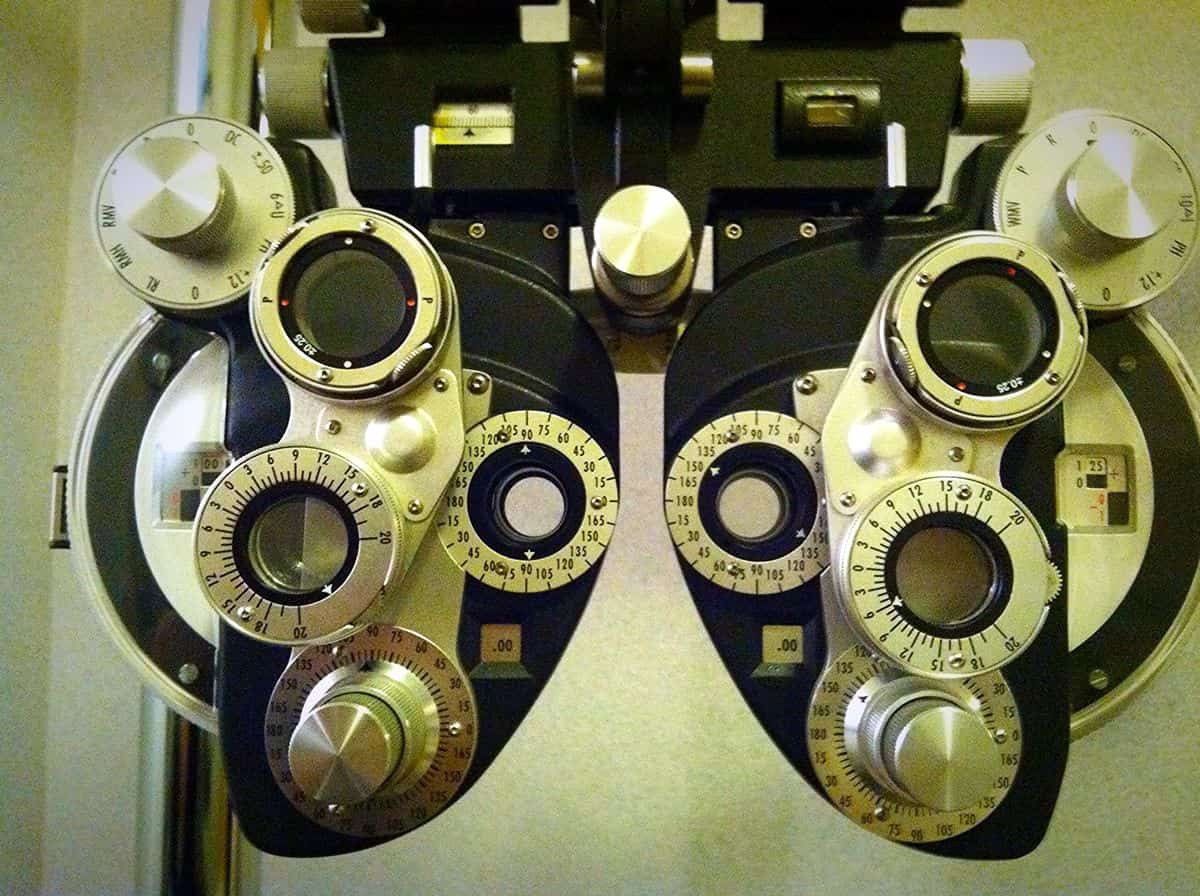 Image of a phoropter, the tool optometrists use to measure visual acuity. One of the goals of accessible mobile UI design is to make your apps more usable for those with vision challenges.