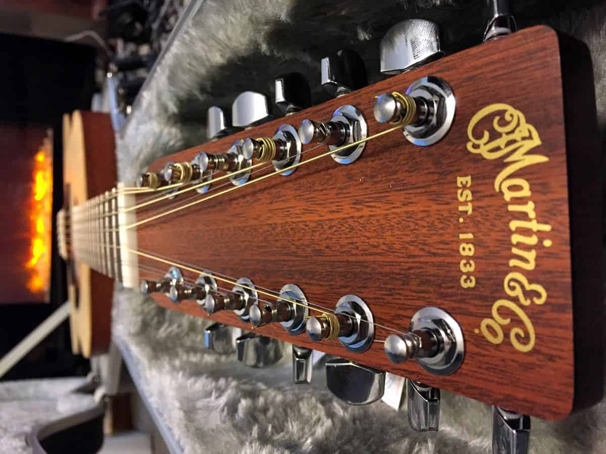 A view down the neck of a 12-string Martin acoustic guitar.