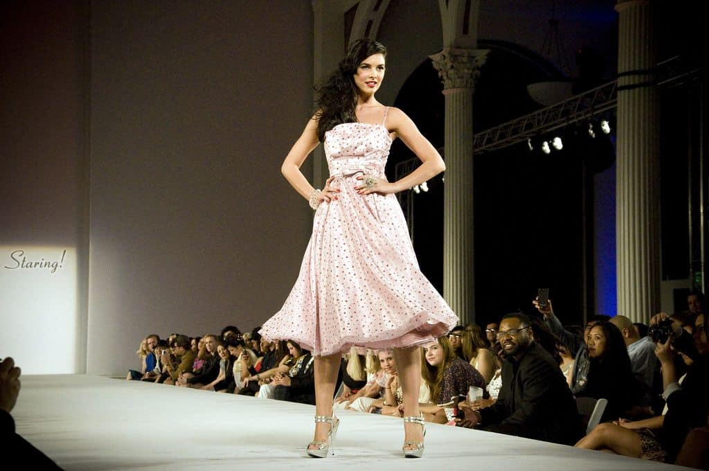 A model walking down the runway for a fashion show. Fashion can be a good place to look for fresh design inspiration.