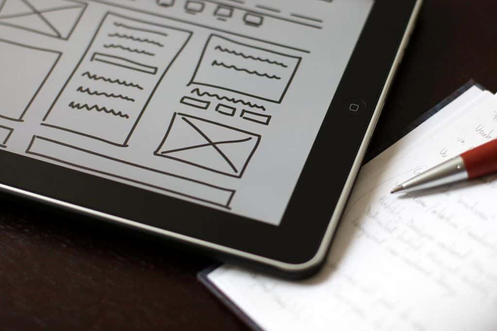 An iPad with wireframes on it, one of the many tasks of UX designers.