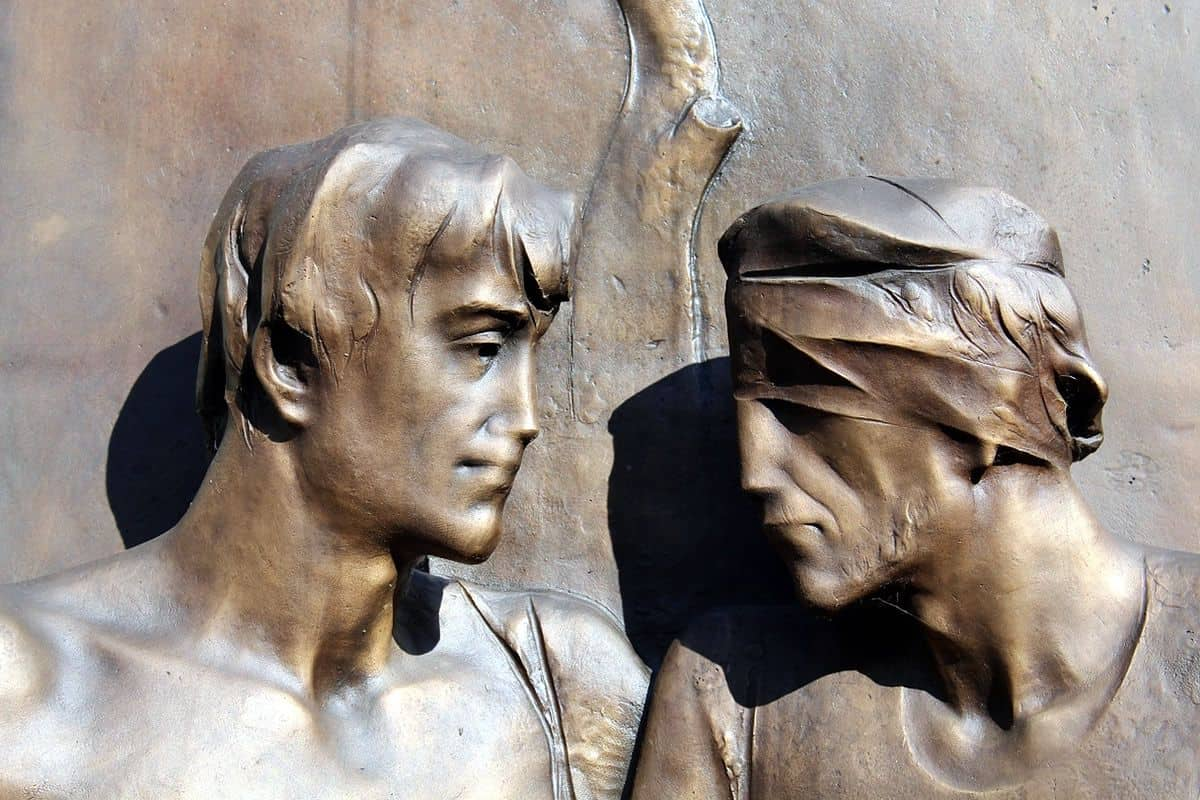 Bronze statue of a man with sight and another blindfolded to signify solidarity with the visually impaired.