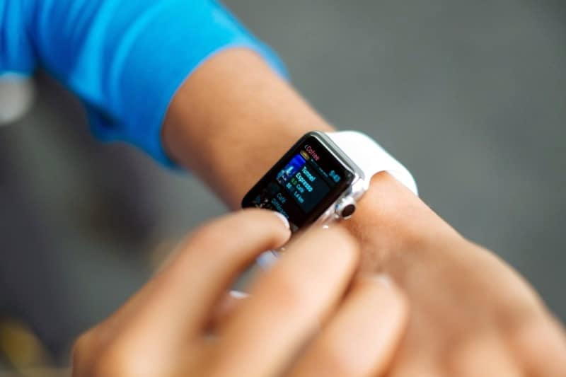 Close up image of person using gesture controls on the Apple Watch.