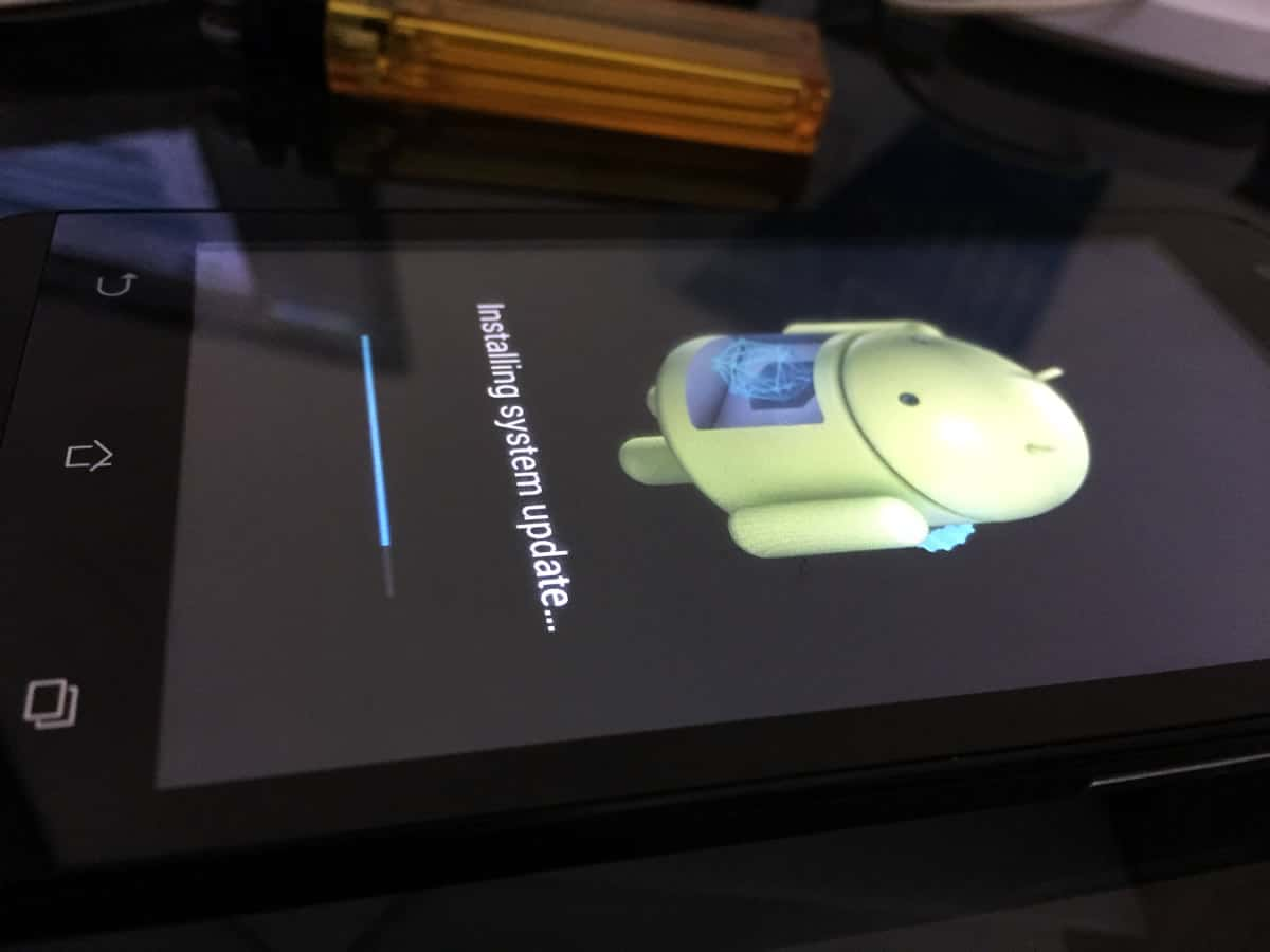 A close-up of an Android smartphone installing a system update.