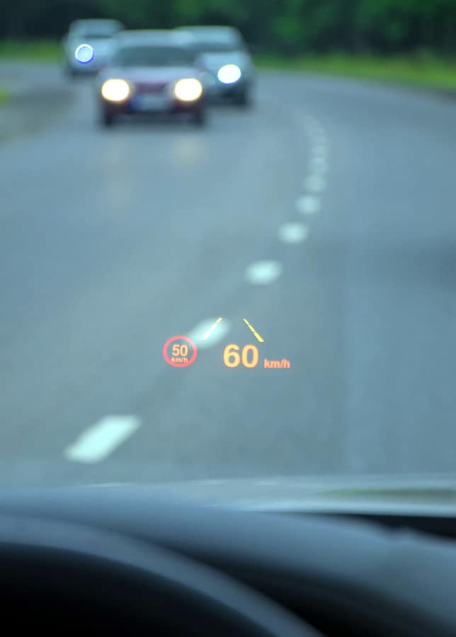 A picture of a heads-up display on the windshield of a car giving speedometer information.