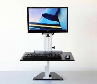 A photo of the Ergo Desktop Kangaroo Pro Junior stand with a computer monitor, keyboard, and mouse.
