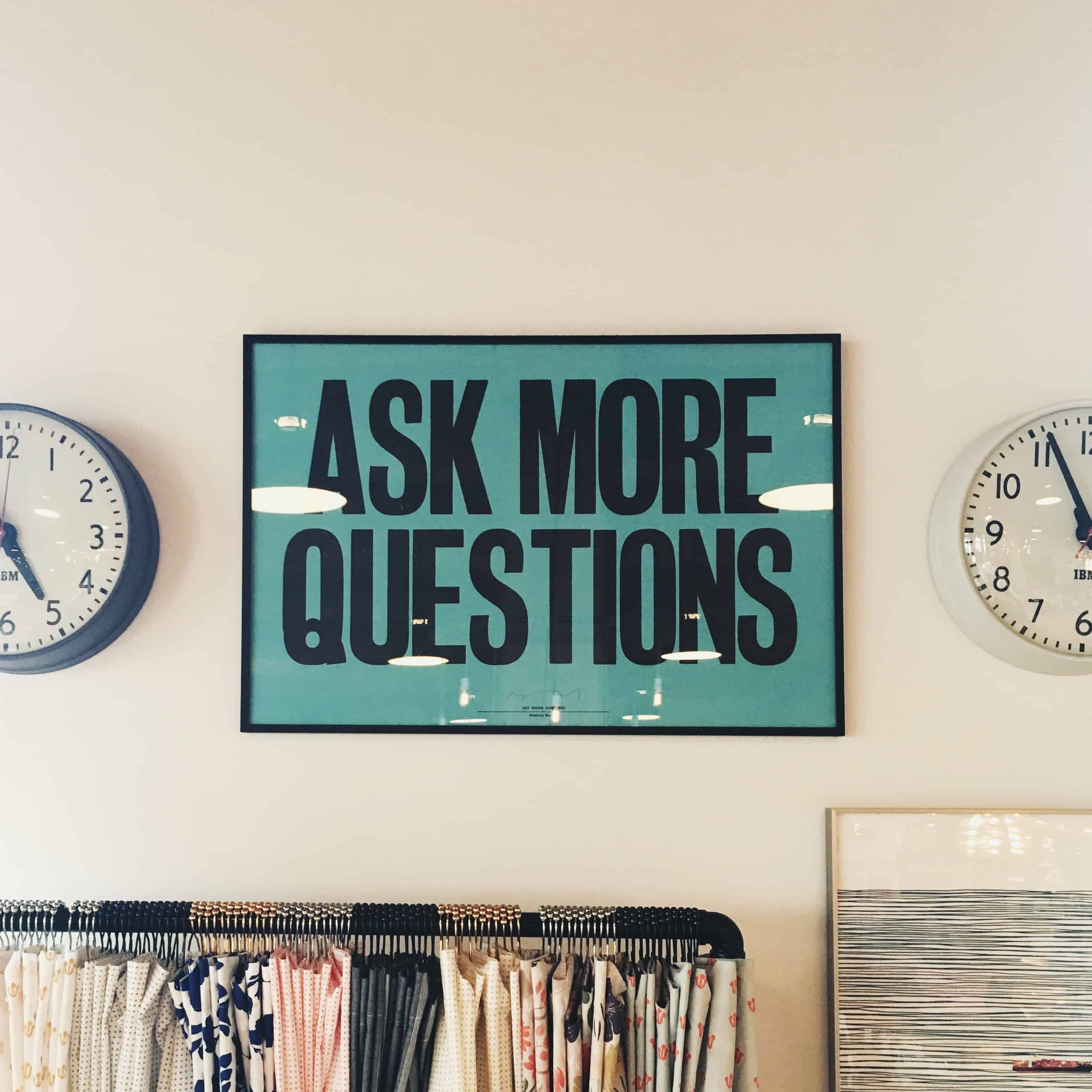 "Image of framed poster that says ""Ask More Questions."""