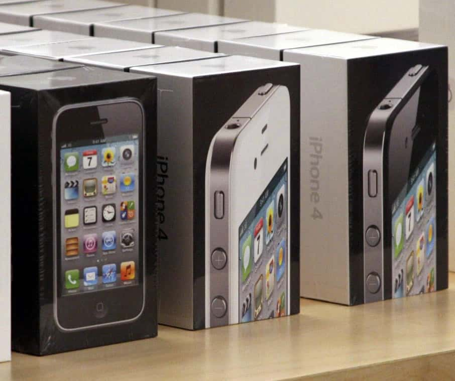 An image of unopened iPhone 3GS boxes next to iPhone 4 boxes.