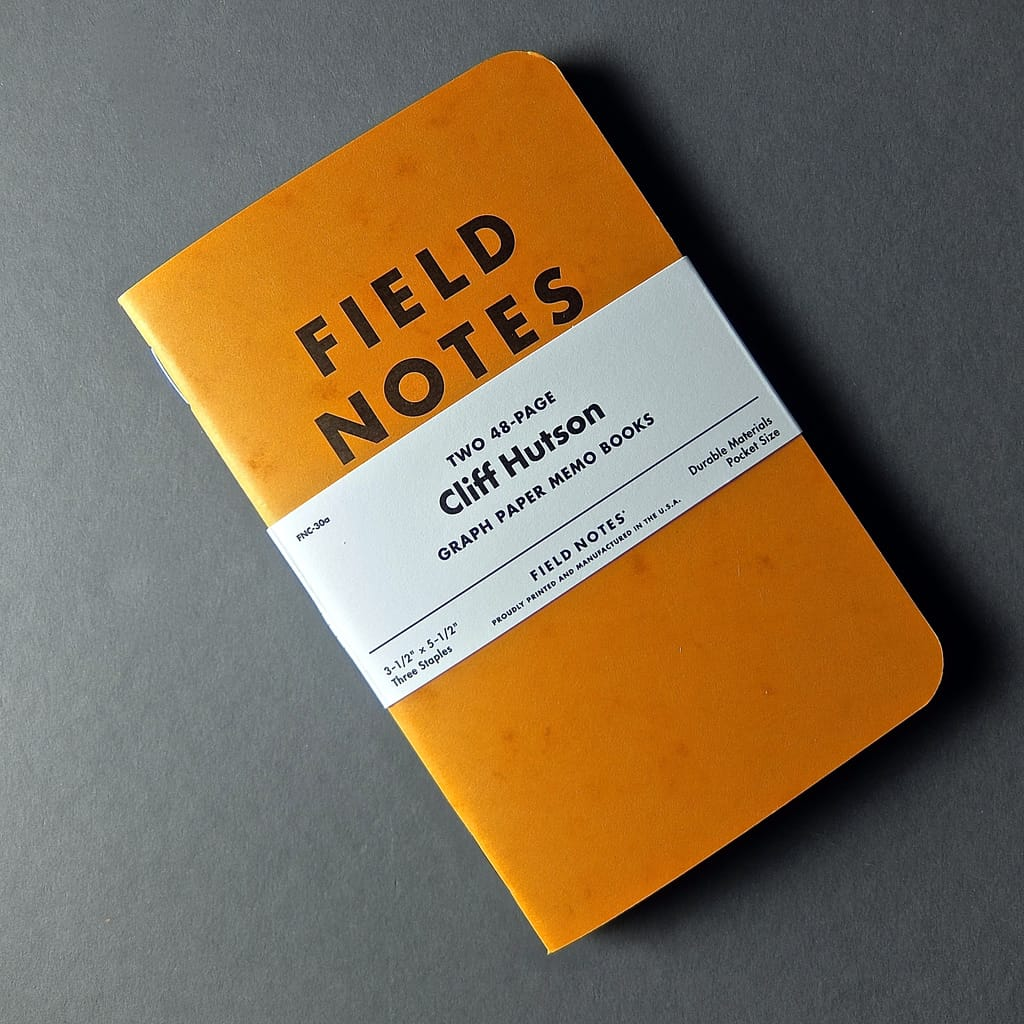 Image of a field notes graph paper memo book notebook orange.