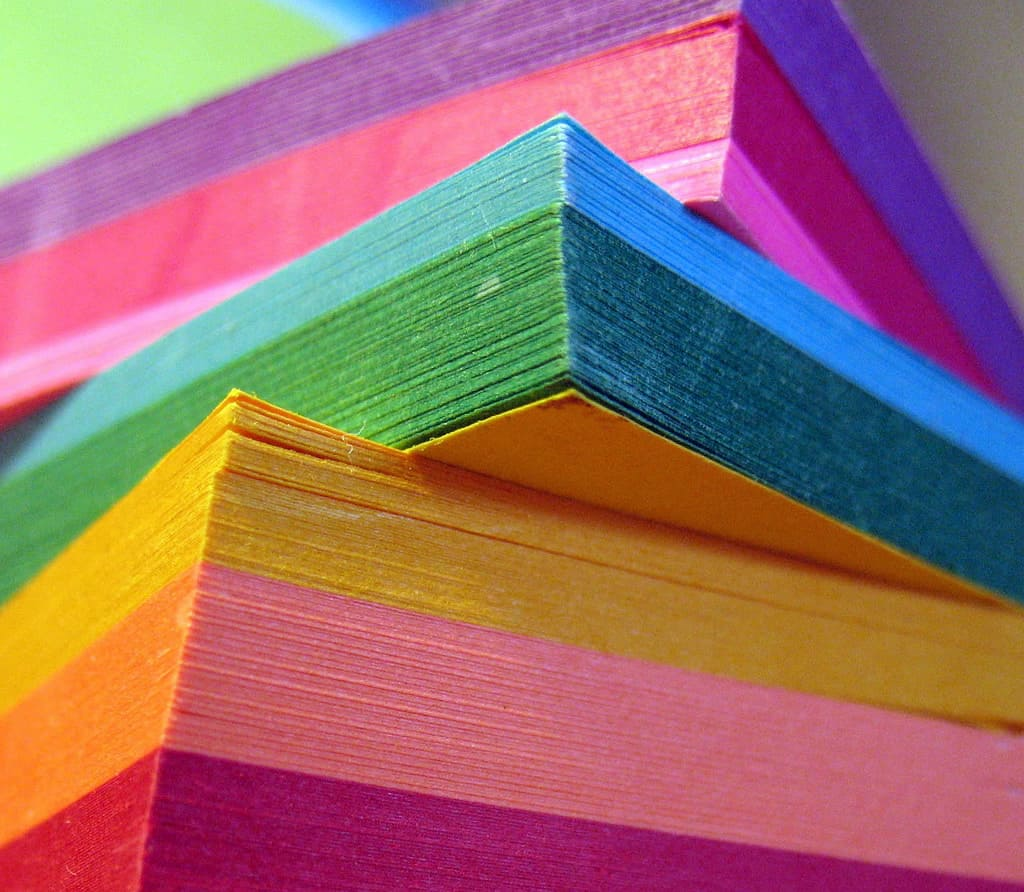 Image of a pile of sticky notes in all different colors.