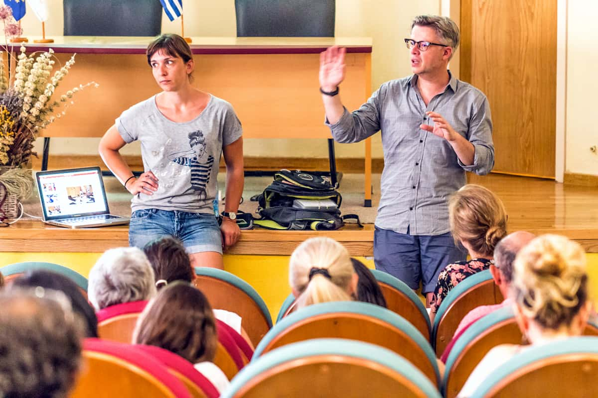 A photo of two people giving a lecture at a conference for mobile app designers.