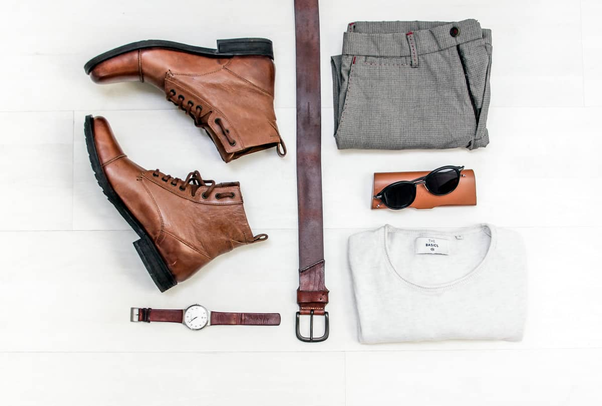 Image of men's fashion accessories organized on a table.