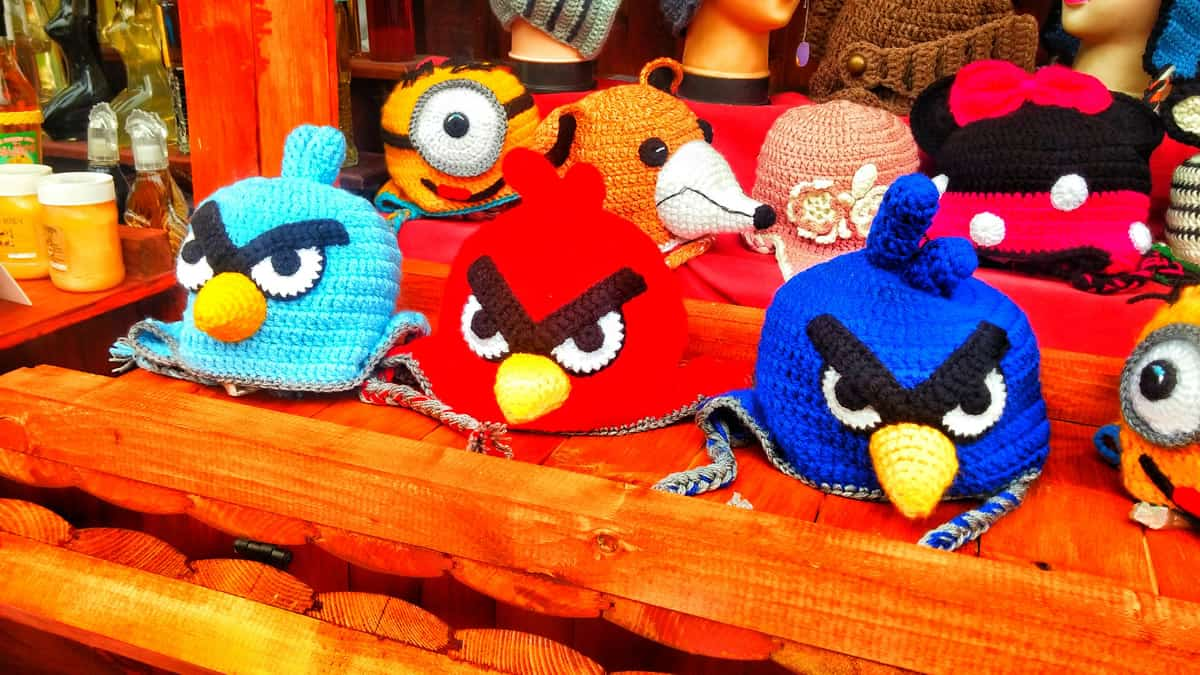 A photo of crocheted Angry Birds hats on display in a store.