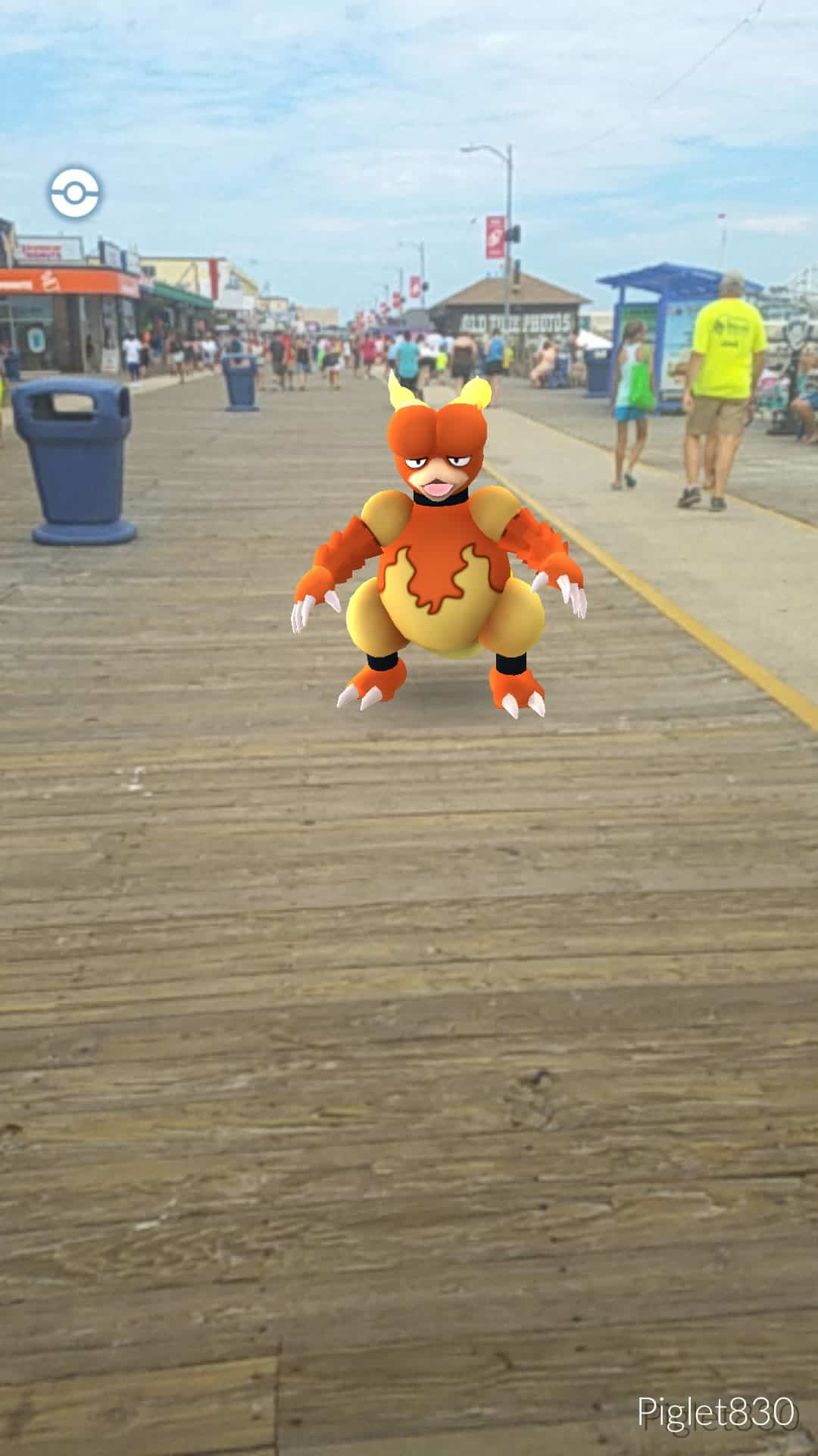 A screenshot of a Pokémon GO character standing on a boardwalk.