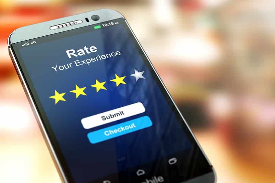 A photo of a mobile phone screen prompting the user to rate their experience in an app.