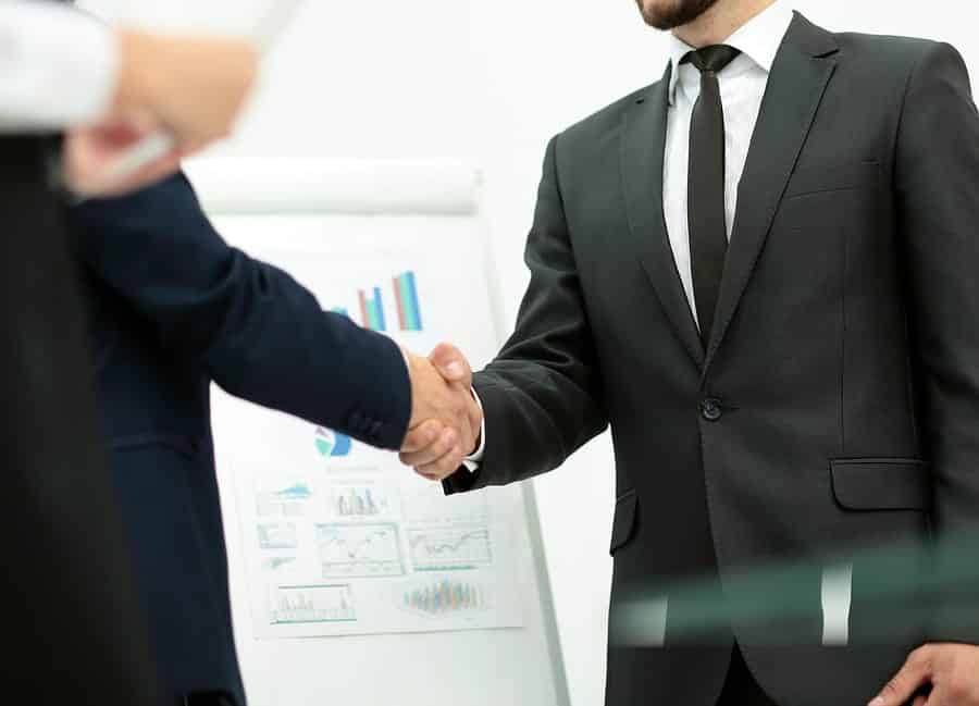 A photo of two gentlemen shaking hands after agreeing upon a business deal.