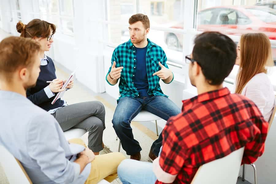 A photo of a small group therapy session.