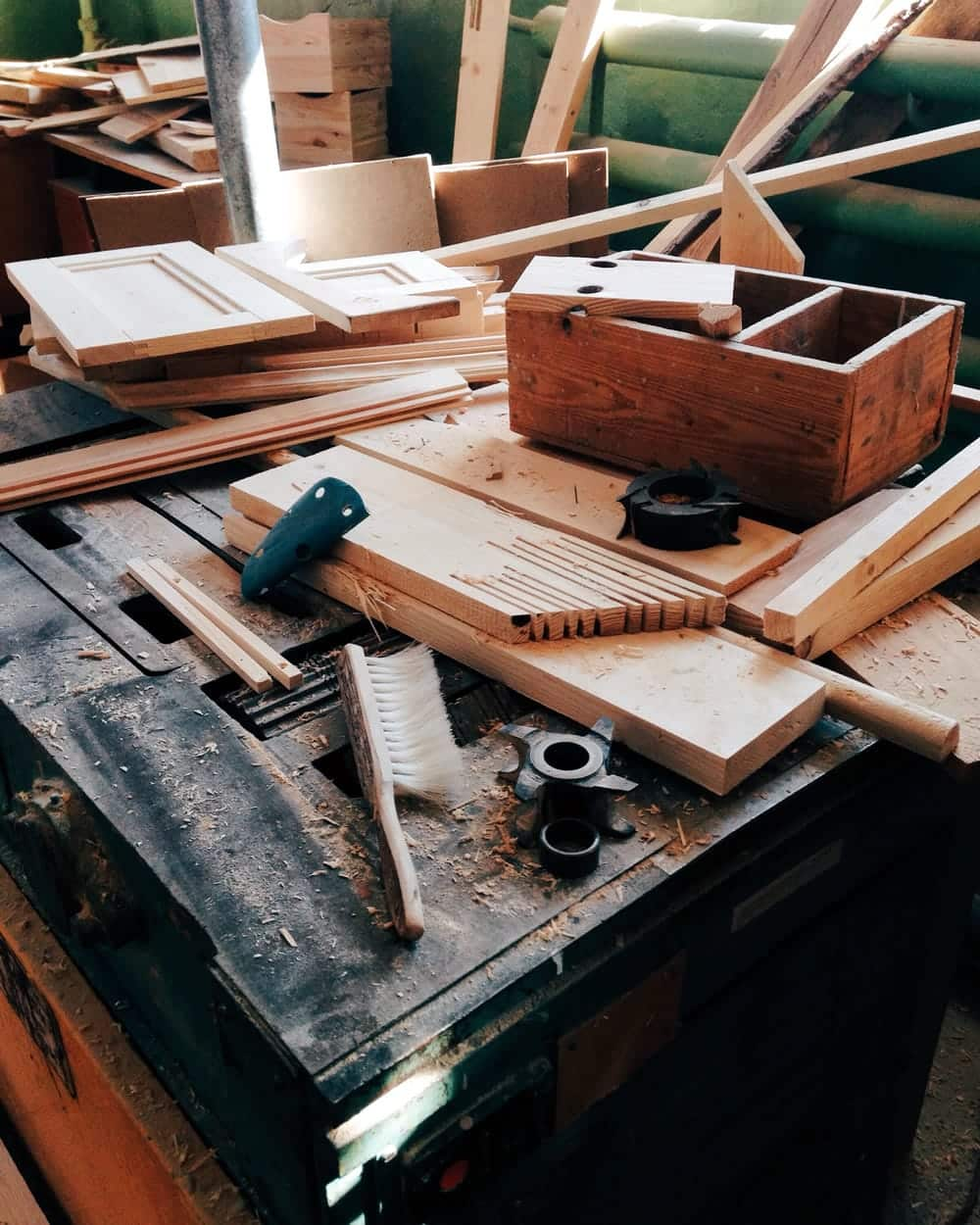 A woodworker tries to figure out a solution to a problem.