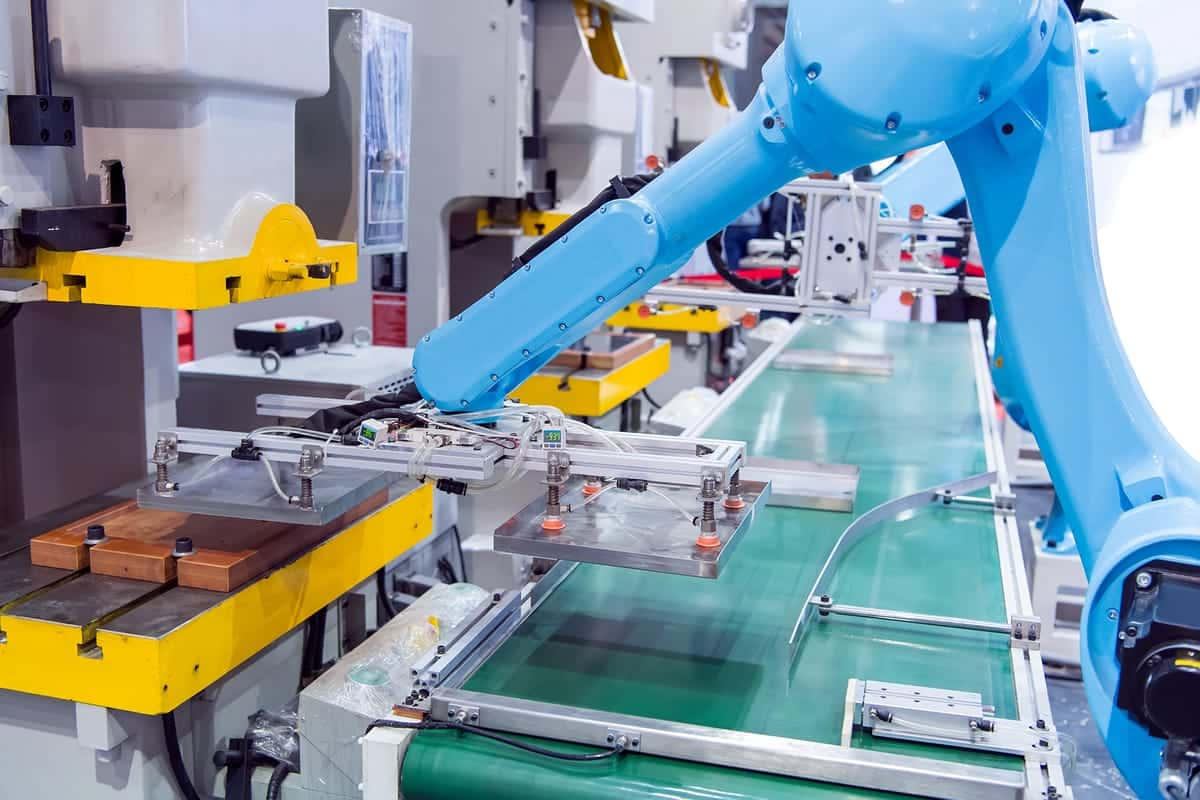 Factory robots assembling products.