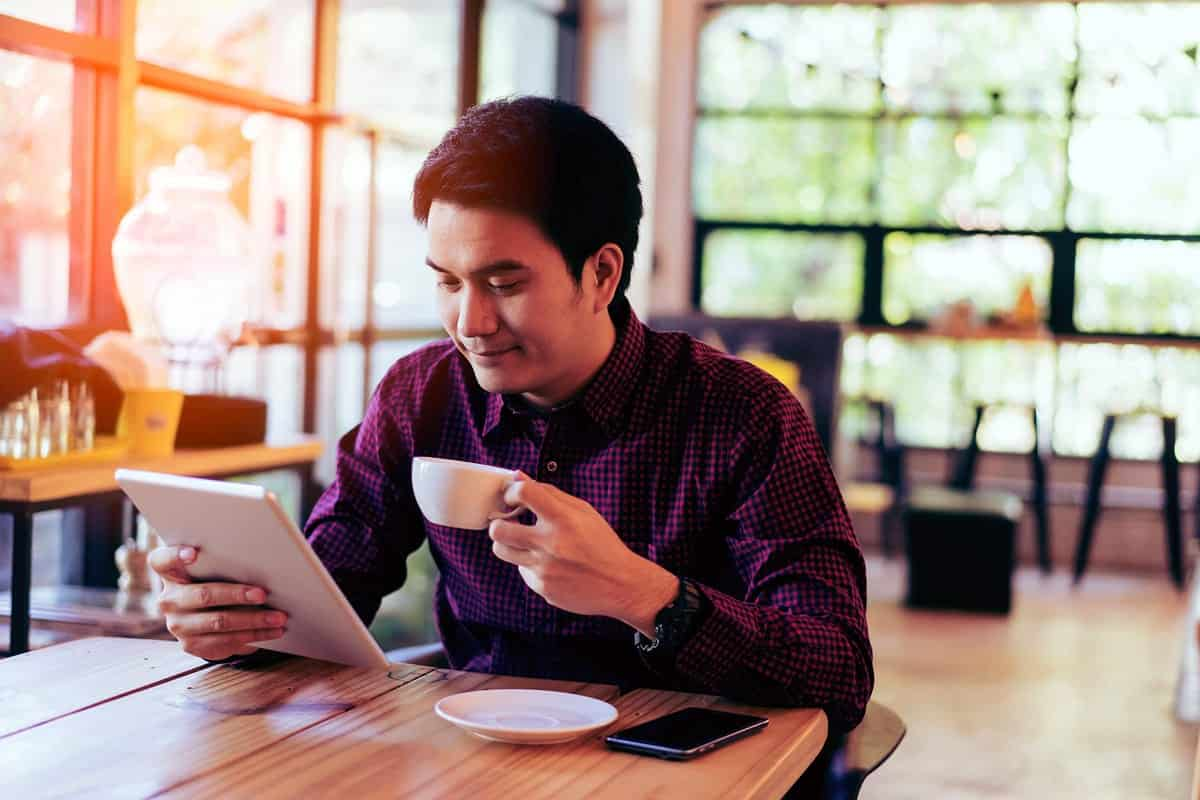 Young businessman on a tablet.