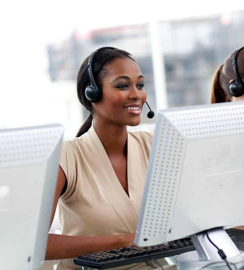 A photo of a customer service representative speaking to a caller through a headset.