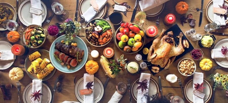 A photo of a Thanksgiving dinner table set and ready for guests.