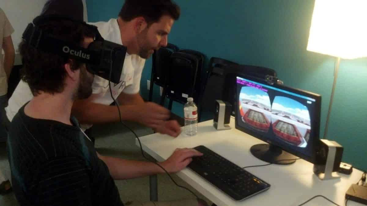 A photo of a person wearing an Oculus Rift while playing a computer game.