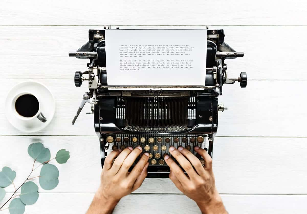 Image of a person typing on a typewriter