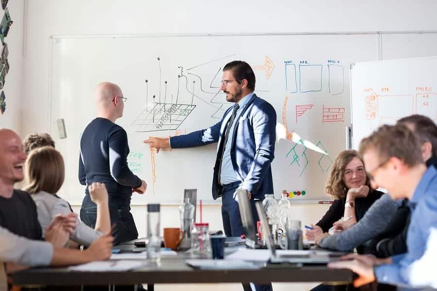 A photo of a team leader discussing a design idea during a design sprint.