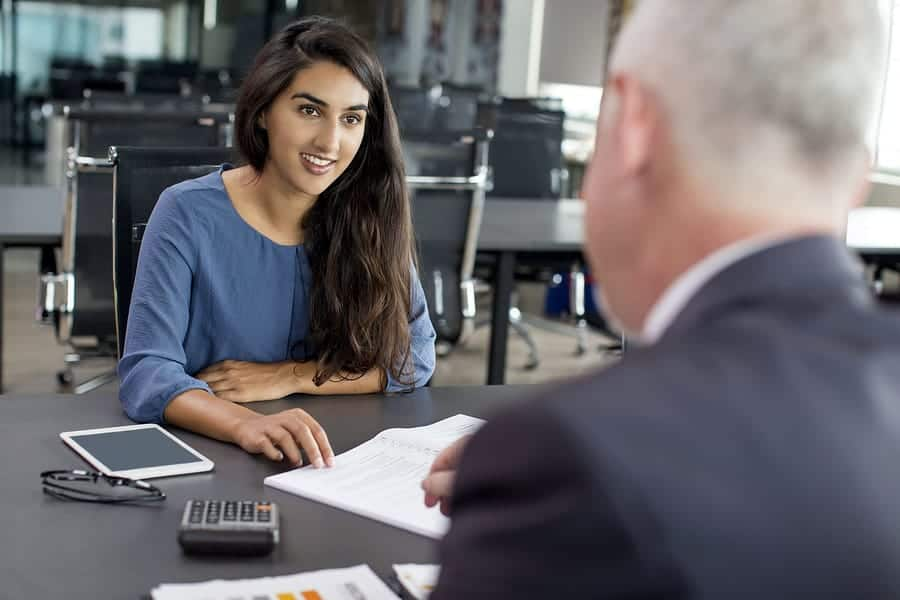 A photo of a woman having a one-on-one meeting with a man.