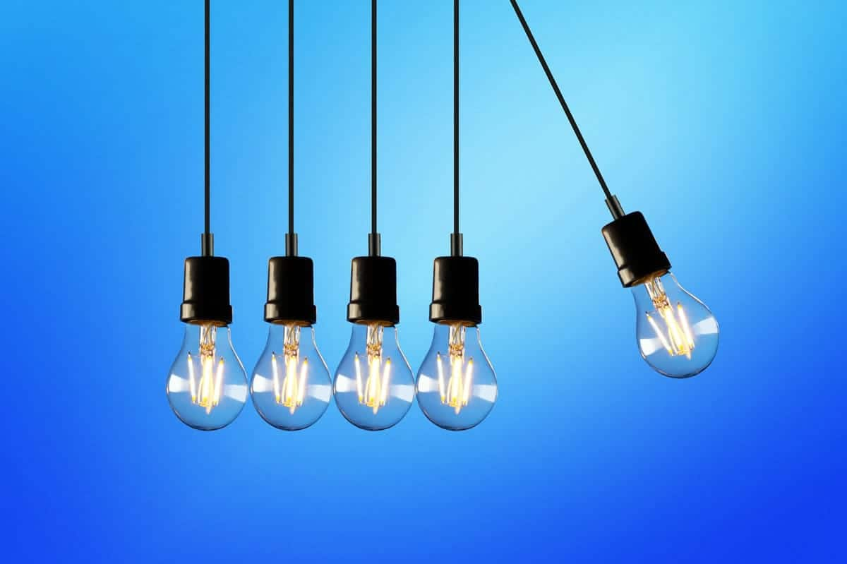 Five lightbulbs on a blue background.
