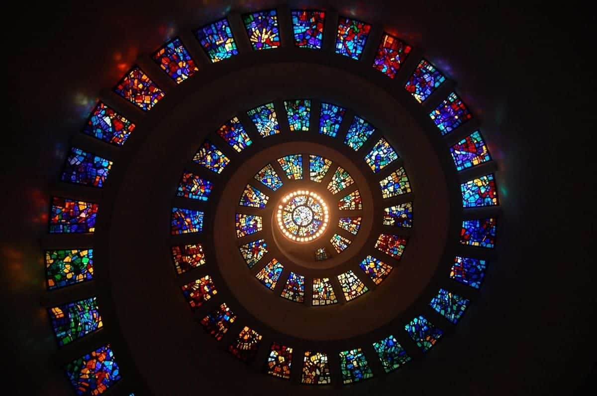 Multi-colored stained glass spiral ceiling.