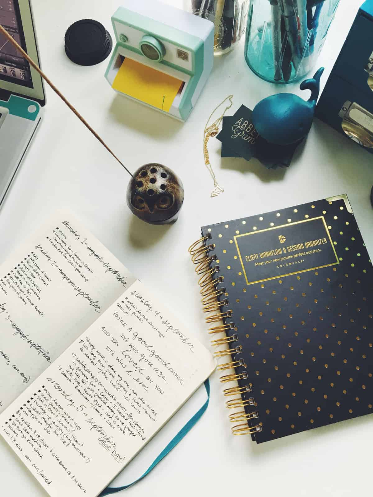 A photo of someone's desk, complete with an organizer and a bullet journal.