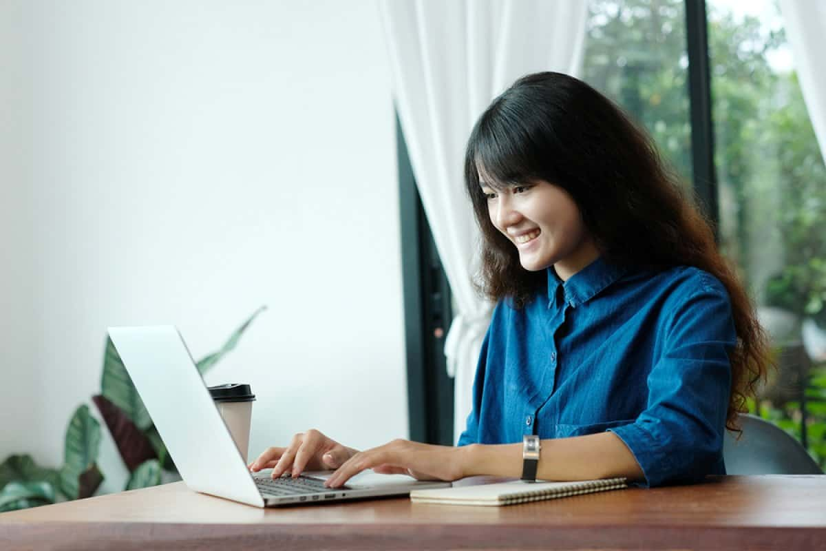 A photo of a young female product manager working in her home office.