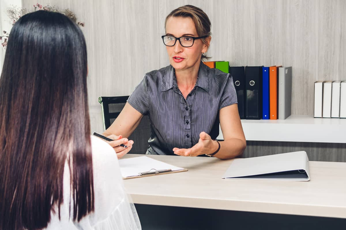 A photo of a woman in a one-on-one interview with another woman.