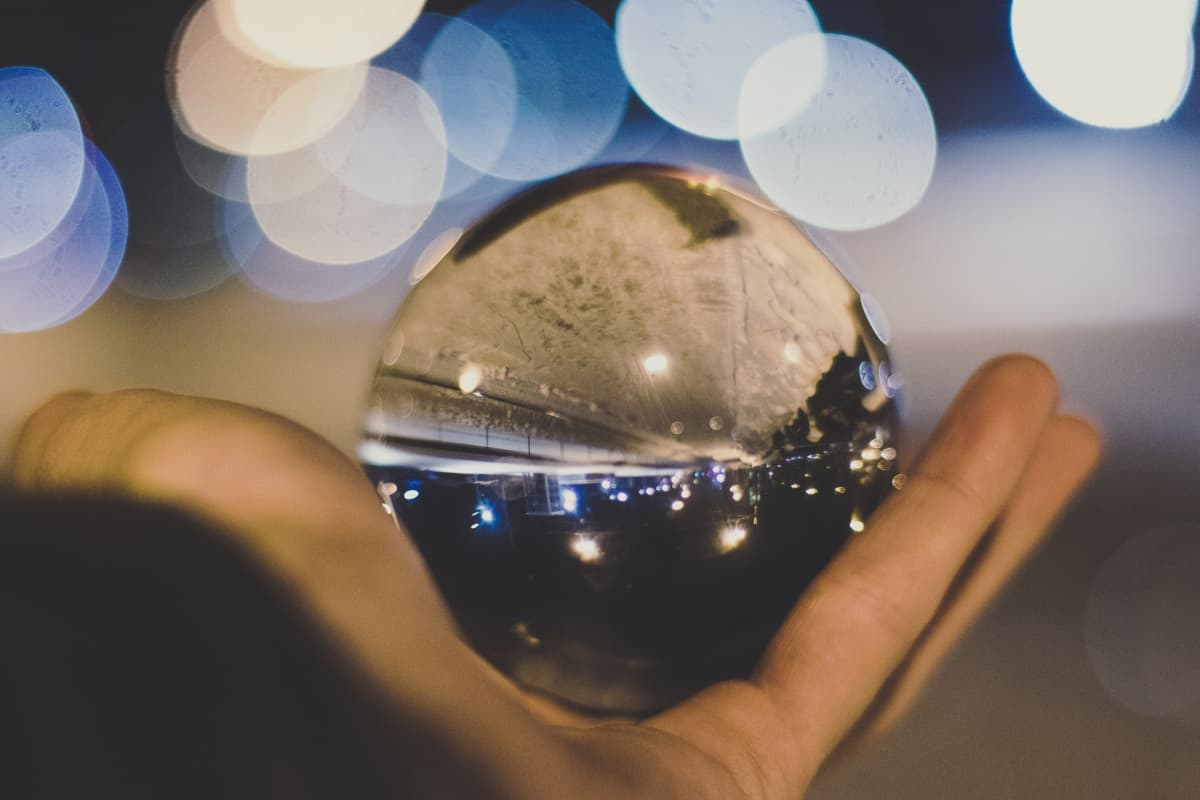 A person holding up a crystal ball.