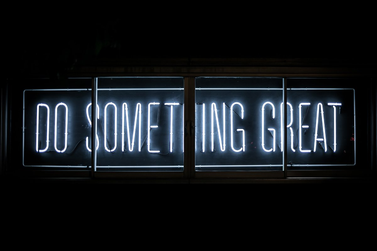 """A photo of a neon sign that says """"Do something great."""""""