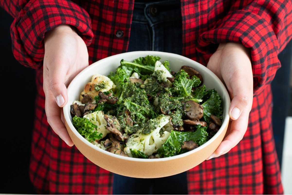 A photo of a broccoli, mushroom, and kale bowl from Fresh and Lean.