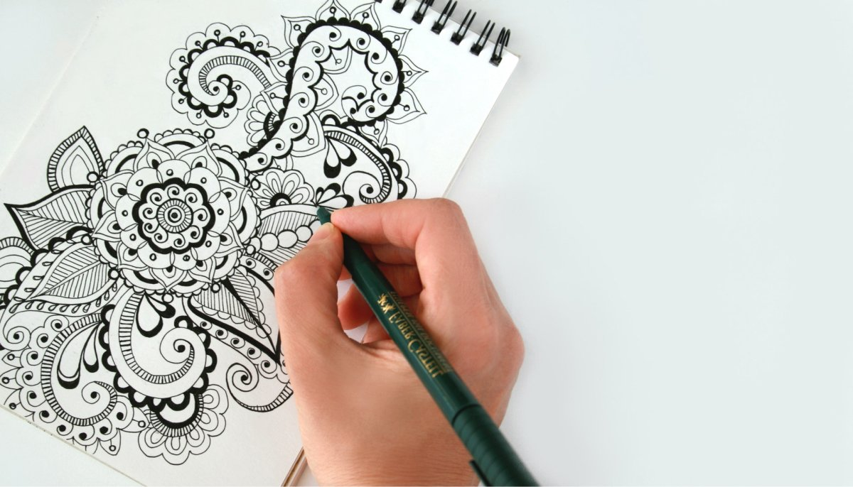 A person working on an intricate drawing.
