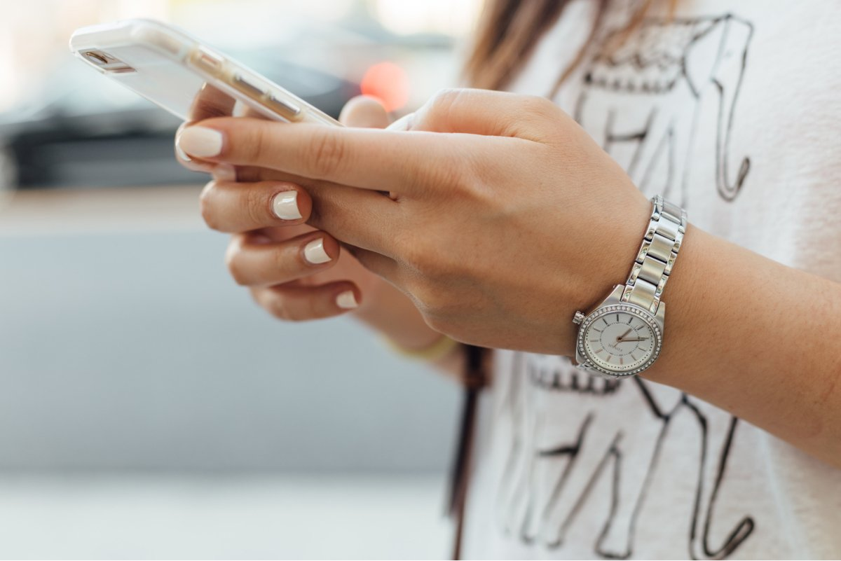 A close-up photo of someone holding a smartphone in their hands.