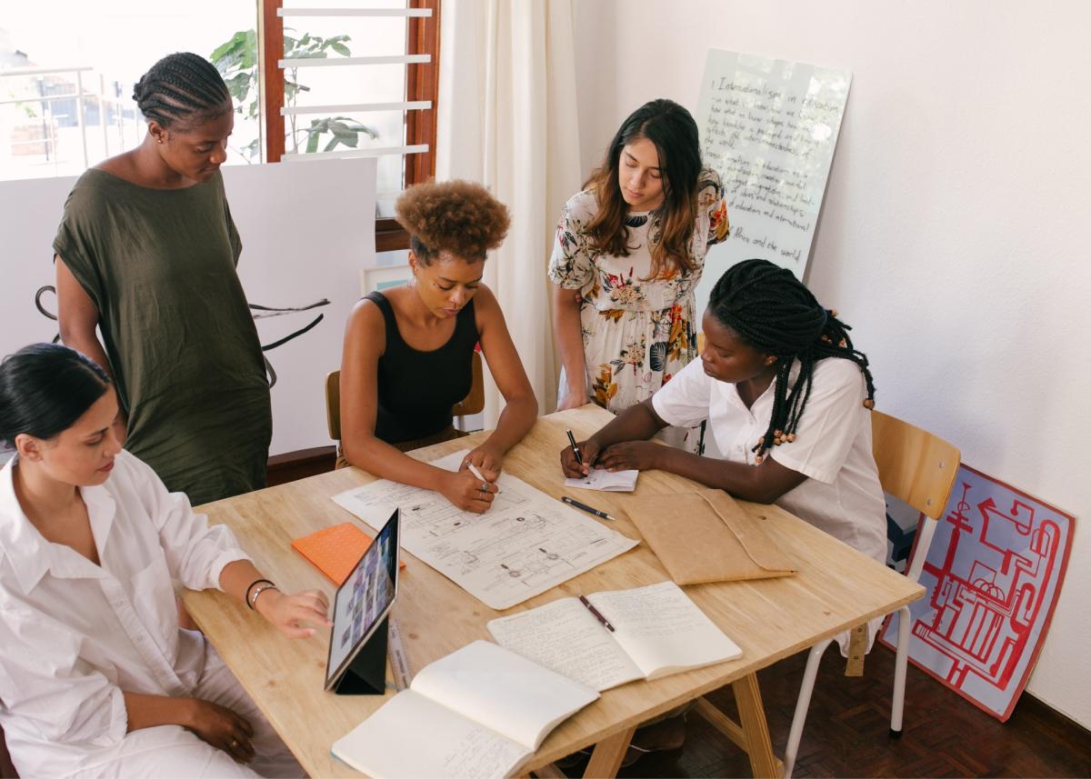 Women meeting to discuss app feedback.