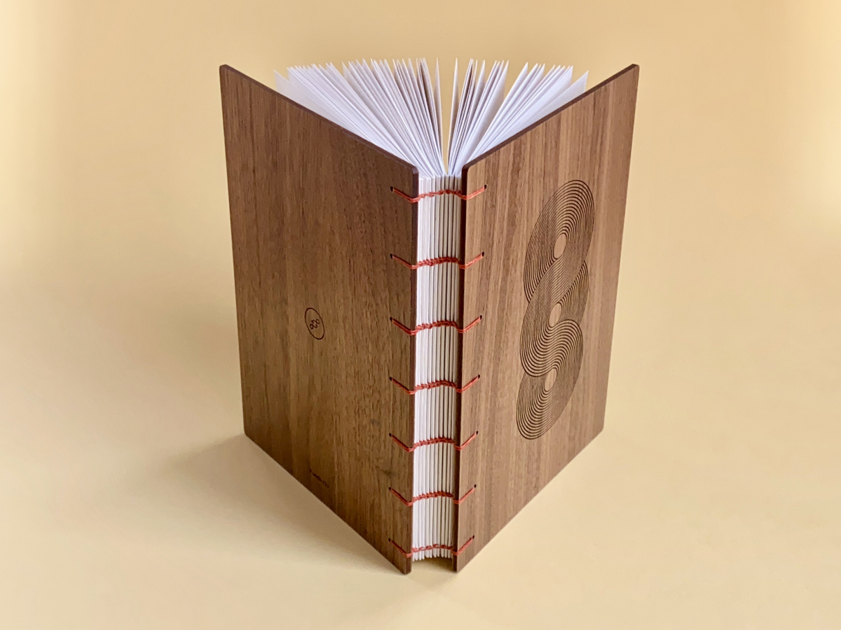 A Fondfolio book with a wooden cover and Coptic binding.